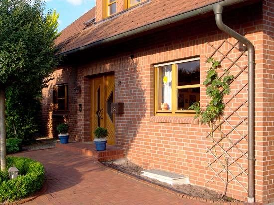 дом, облицованный клинкерной плиткой под кирпич