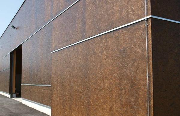 Внешний вид фасада из ОСБ с декоративным покрытием
